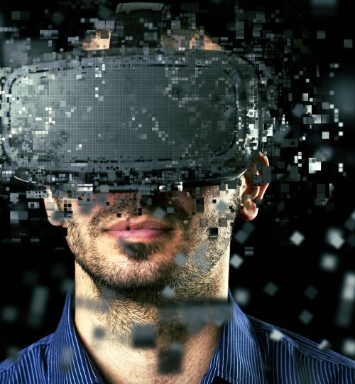 Man wearing virtual reality headset on dark background